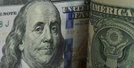 Фрагмент банкноты номиналом 100 долларов США. Архивное фото