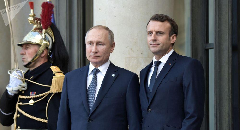 Россиянын президенти Владимир Путин менен Франциянын башчысы Эммануэль Макрон. Архив