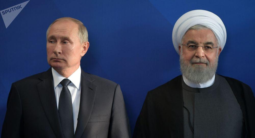 Россиянын президенти Владимир Путин жана Ирандын президенти Хасан Роухани. Архив
