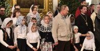 Президент РФ Владимир Путин во время Рождественского богослужения в Спасо-Преображенском соборе всей гвардии в Санкт-Петербурге.
