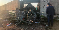 Обломки самолета Boeing 737 после авиакатастрофы на окраине Тегерана. Иран, 8 января 2019 года