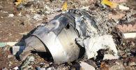 Обломки самолета, принадлежащего Международным авиакомпаниям Украины, который разбился после взлета из иранского аэропорта Имама Хомейни на окраине Тегерана. Иран, 8 января 2020 года