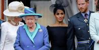 Елизавета II, ханзаада Гарри менен жубайы Меган Маркл. Архивдик сүрөт