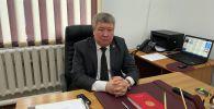 Апостилдештирүү жана нотариат башкармалыгынын башчысы Урмат Акулуев. Архив