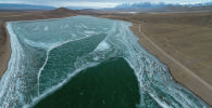 Замершее озеро Ара-Кол в Кочкорском районе Нарынской области. Архивное фото