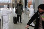 Ухань шаарынын аэропортундагы жүргүнчүлөр