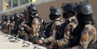 Военнослужащие иракских сил безопасности около здании посольства США в Багдаде, Ирак. 1 января 2020 года