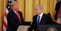 АКШ президенти Дональд Трамп жана Израиль премьер-министри Биньямин Нетаньяху. Архивдик сүрөт