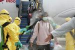 Уханьдан Индонезияга алынып келген жарандарды дезинфекциялоо. Архивдик сүрөт