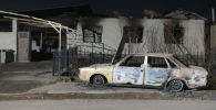 Сгоревший автомобиль в приграничном селе Масанчи в Кордайском районе Жамбыльской области Казахстана