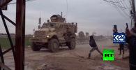 Телеканал RT Arabic и агентства Kurdistan24 и SANA опубликовали видео конфликта между американскими солдатами и жителями города Камышлы (Сирия).