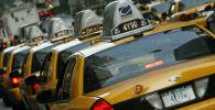 Такси на одном из улиц Нью-Йорка. Архивное фото