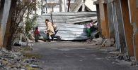 Сириянын Дума шаарынын көчөлөрүнүн биринде ойногон балдар. Архивдик сүрөт