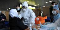 Учения на случай выявления человека с коронавирусом в аэропорту Манас. Архивное фото
