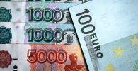 Евро жана рубль акчалары. Архивдик сүрөт