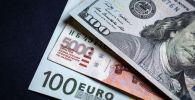 Денежные купюры: евро, доллары и российские рубли. Архивное фото