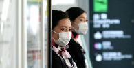 Девушки в медицинских масках. Архивное фото