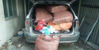 Ош: аткезчилик менен 80 миң бет кап алып киргендер