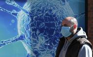 Медициналык маска кийген адам
