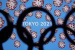 Токиодо өтө турган Олимпиада оюндарынын логотиби. Архив