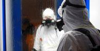 Дезинфекционная обработка в жилом доме в рамках профилактики коронавируса. Архивное фото