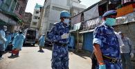 Индиядагы полиция кызматкерлери. Архивдик сурөт