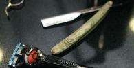 Ножницы и бритва. Архивное фото