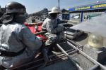 Пожарные, носящие маски для лица, распыляют дезинфицирующее средство на улицах в Бишкеке. Архивное фото