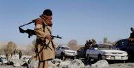 Ооганстандын Нангархар провинциясындагы өткөрмө бекетте Талибан радикал согушкери. Архив