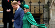 Британиянын ханзаадасы Гарри жана анын жубайы Меган Маркл. Архив