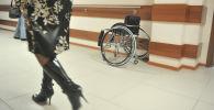 Майып коляскасы. Архив