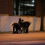 Атлант шаарында полиция кызматкерлерине кармалган фотограф