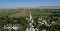 Кыргыз-казак мамлекеттик чек арасындагы жүк ташуучулардын кезеги. Архивдик сүрөт