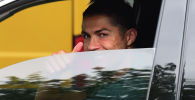 Криштиану Роналду за рулем автомобиля. Архивное фото